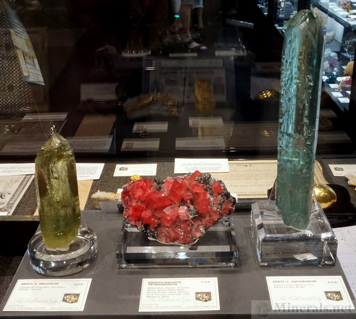 Left to Right: Beryl var Heliodor from Volodarsk-Volynskii, Ukraine, Rhodochroite with Tetrahedrite from the Millenium Pocket, Sweet Home Mine, Alma, CO, Beryl var Aquamarine from the Angicos Mine, Medina City, Minas Gerais, Brazil