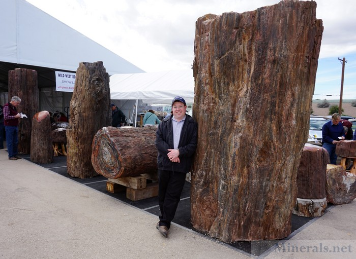 Posing in front of Giant Petrified Wood Logs, Between the Main and Showcase Tents